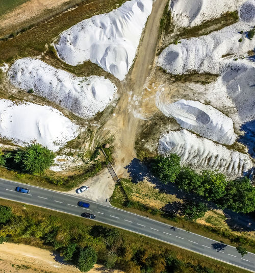 heaps wit quartz sand Drone  Drone Dji Quartz Aerial Aerial Photography Aerial View Beauty In Nature Cold Temperature Day Drone Photography Droneshot Heap High Angle View Landscape Nature No People Outdoors Pit Quarry Sand Scenics Sky Tree Water White