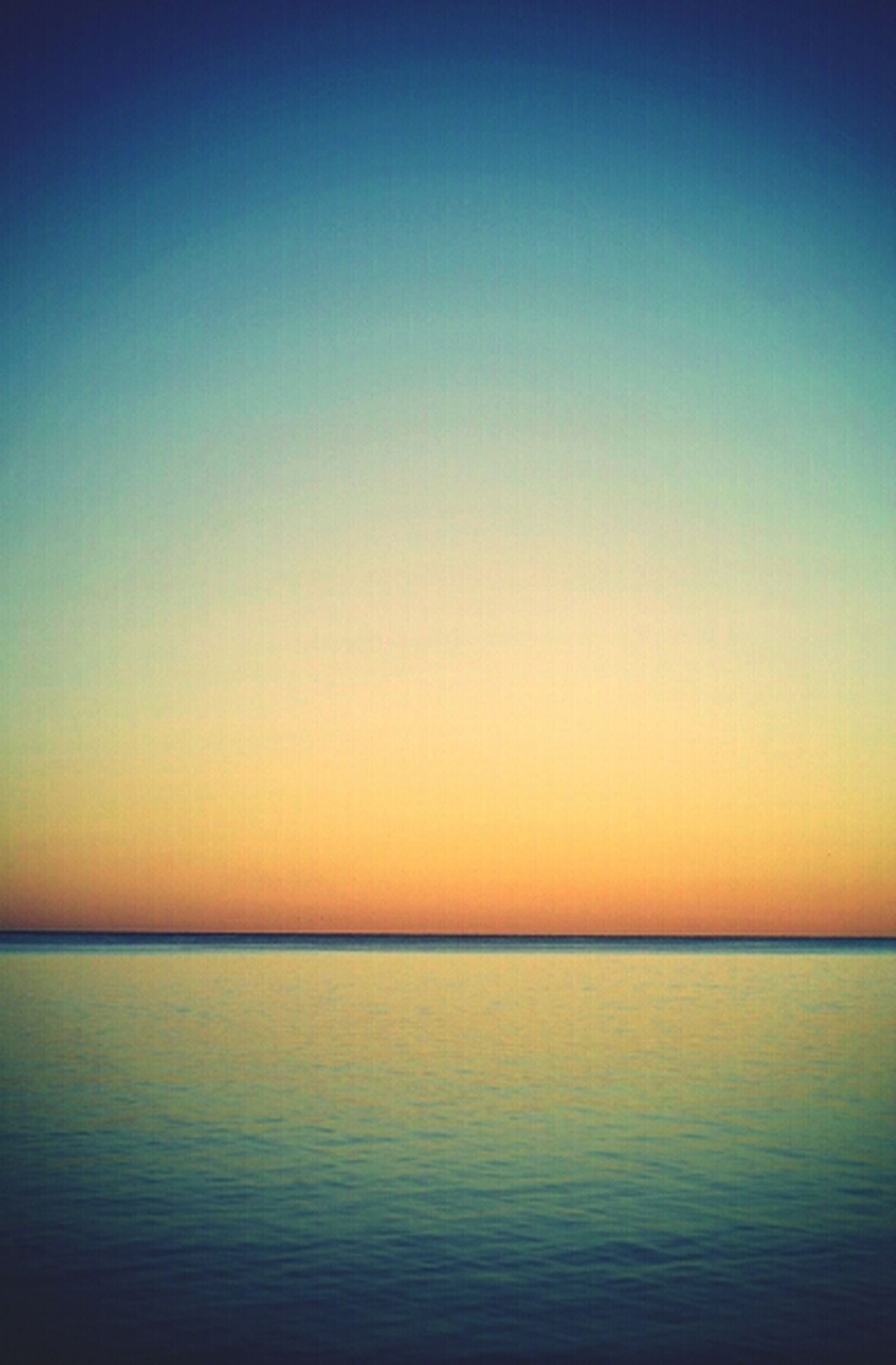 sea, water, copy space, tranquil scene, scenics, clear sky, tranquility, horizon over water, sunset, waterfront, beauty in nature, nature, idyllic, blue, orange color, rippled, seascape, dusk, calm, ocean