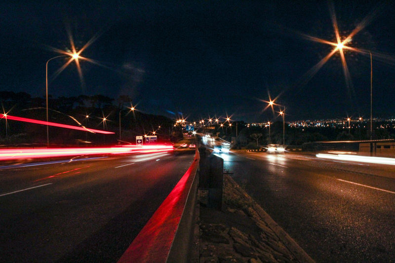 Capturing Motion Night Illuminated Traffic Transportation Light Trail Long Exposure Speed Road Car Motion Street Blurred Motion Sky City Land Vehicle No People Outdoors Horizontal Architecture Bridge - Man Made Structure Cape Town Uct Highway Risky