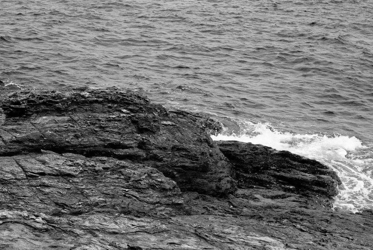 sea, water, wave, nature, no people, rock - object, beauty in nature, high angle view, outdoors, day, power in nature, force