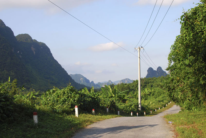 Country roads in Phong Nha National Park Countryside Day Diminishing Perspective Empty Green Landscape Long Mountain Mountain Range Outdoors Phong Nha Phongnha Power Line  Remote Road Scenics Sky Solitude South East Asia The Way Forward Tranquil Scene Tranquility Transportation Tree Vietnam