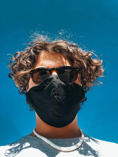 Portrait of man wearing sunglasses at swimming pool
