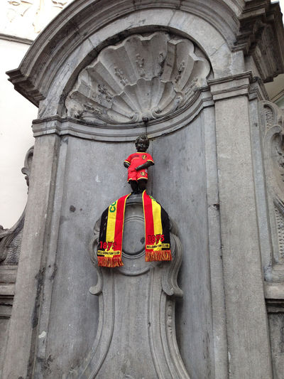 Manneken Pis statue dressed in the Belgian football kit before a football match Brussels Europe Capital Cities  Manneken Pis Red Devils Belgium Urine Architecture Day No People Built Structure Representation Low Angle View Human Representation Art And Craft Craft Building Exterior Outdoors Sculpture Male Likeness Travel Statue Travel Destinations Creativity Nature Red Protection