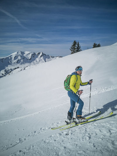 Full length of person skiing on snowcapped mountain