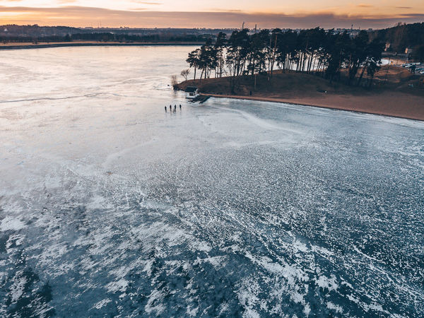 Walking on ice Aerial Shot Drone  Lietuva Winter Aerial View Beauty In Nature Cold Temperature Day Frozen Water High Angle View Lake Mavic Pro Nature Non-urban Scene Outdoors People Scenics - Nature Sky Sunset Tranquil Scene Tranquility Tree Walking On Ice Water Waterfront