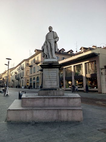 City Sky Architecture Built Structure Building Exterior Outdoors Sculpture Day Statue Italy Photos Travel Destinations Piemonte Novara City History Cavour Italy Architecture