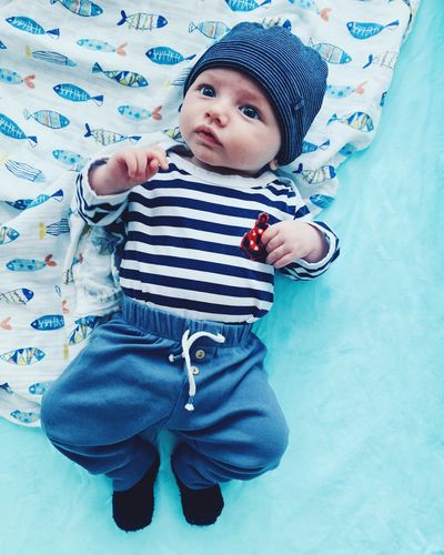 Child One Person Childhood Real People Front View Leisure Activity Casual Clothing High Angle View Lifestyles Standing Indoors  Boys Bed Males  Cute Three Quarter Length Lying Down Innocence Cute Boy Baby Boy Newborn Marine Sailor