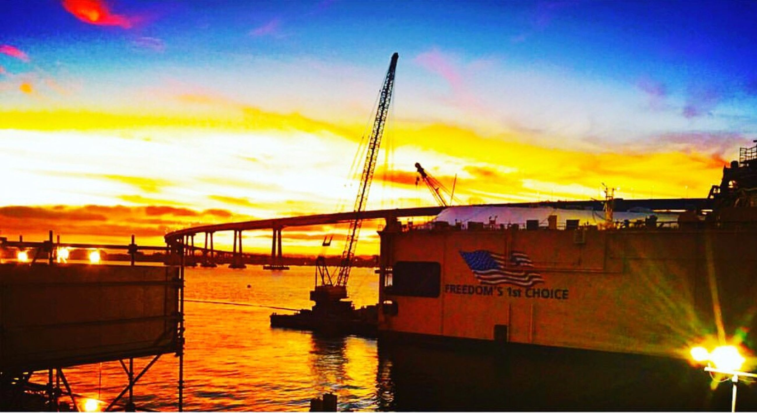 sunset, sky, water, built structure, orange color, architecture, sea, transportation, city, no people, outdoors, building exterior, cloud - sky, nautical vessel, nature, silhouette, bridge - man made structure, beauty in nature, harbor, day