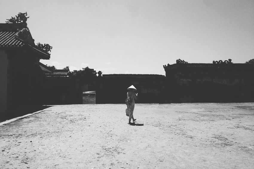 Walking Through The Past People And Places Vietnam Vietnamesegirl Vietnam Travel Imperial Palace Huế Street Photography History Walking Building Exterior Architectural Feature Architecture Street Fashion Outdoor Tranquil Scene Solitude Monochrome Monochrome Photography