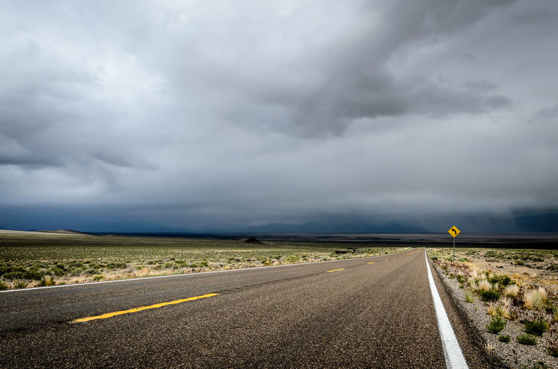Threatening Sky USA Asphalt Cloud - Sky Direction Dividing Line Environment Highway Landscape Marking Nature Nevada No People Ominous Outdoors Rain Road Road Marking Sign Sky Storm Storm Cloud Symbol The Way Forward Transportation