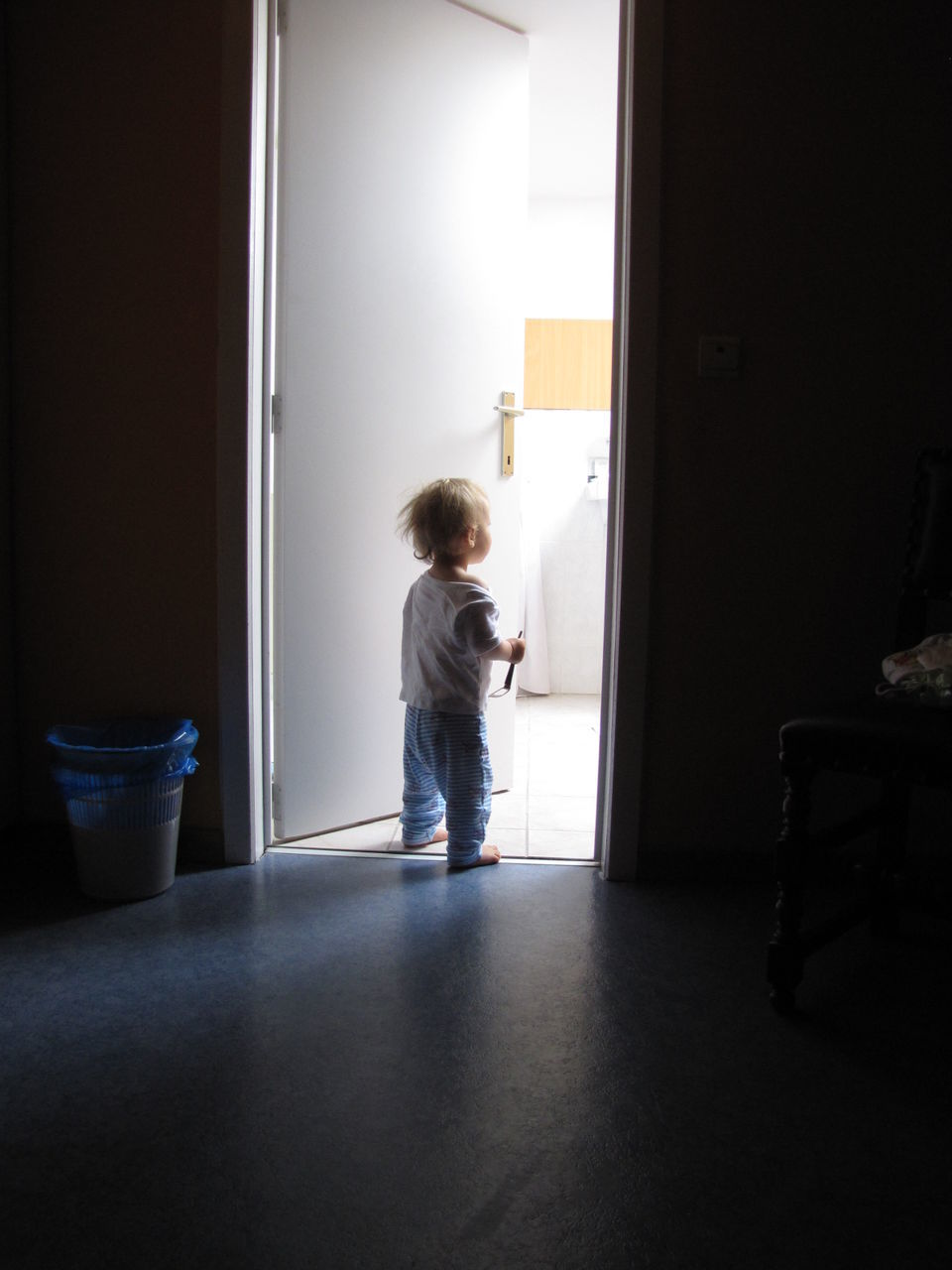 childhood, child, full length, indoors, standing, one person, boys, real people, casual clothing, entrance, door, men, males, offspring, home interior, innocence, lifestyles, domestic room, day, contemplation, waiting