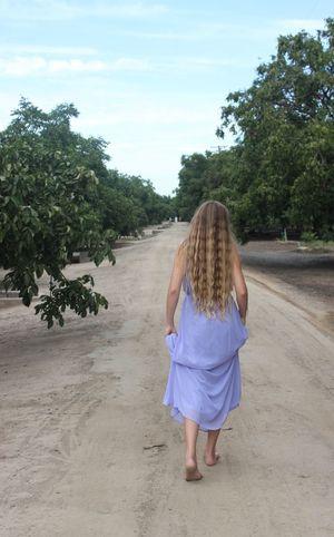 Girl Walking Orchard Path