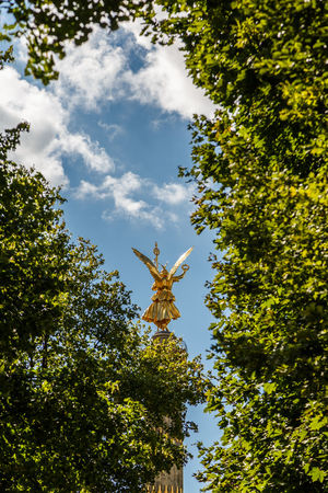 Paint The Town Yellow Trees Architecture Berlin Siegessäule Berlin Victory Column Branch Cloud - Sky Cross Day Growth Low Angle View Nature No People Outdoors Sculpture Sky Statue Tree