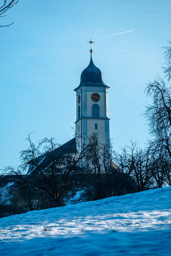 Architecture Building Exterior Built Structure Clock Tower Cold Temperature Day Knutwil Nature No People Outdoors Place Of Worship Religion Sky Snow Switzerland Tree Winter