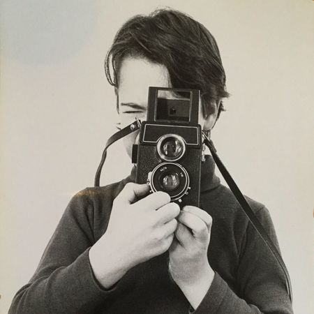 Young boy with old camera Twin Lens Reflex Photography Themes Camera - Photographic Equipment Photographing Retro Styled One Person Studio Shot Holding Technology Leisure Activity Photographer Old-fashioned Real People White Background Portrait Indoors