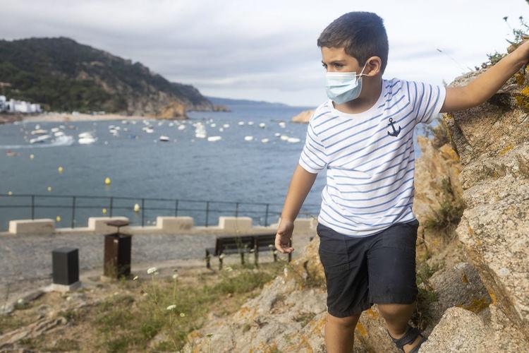 Child on vacation on the coast near the sea