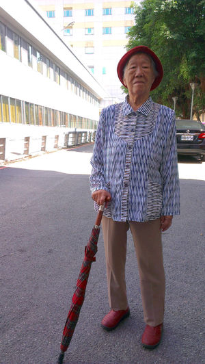 Casual Clothing Front View Leisure Activity Lifestyles Old Lady Old Woman Person Red Hat Standing