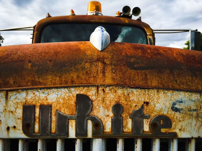 Abandoned Rusty Car Against Sky