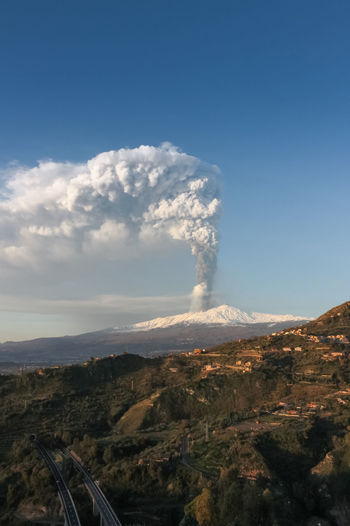 Sky Mountain Environment Smoke - Physical Structure Landscape Volcano Nature Day No People Scenics - Nature Beauty In Nature Geology Cloud - Sky Erupting Outdoors Land Non-urban Scene Pollution Physical Geography Emitting Air Pollution Power In Nature Volcanic Crater