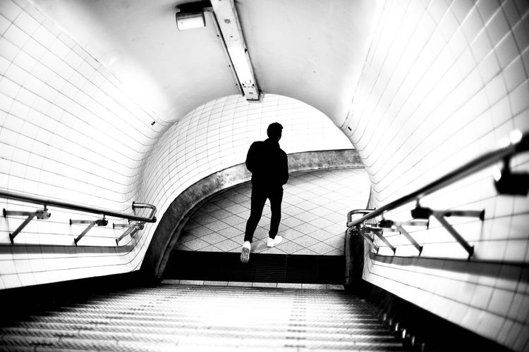 On The Way Black & White Bnw_collection Black And White Bnw EyeEm Selects EyeEm Gallery The Week on EyeEm Editor's Picks Steps And Staircases Steps Real People Railing Indoors  Staircase One Person Full Length Men Rear View Convenience Architecture Built Structure Subway Station Technology Illuminated One Man Only Day Only Men Mobility In Mega Cities Adventures In The City