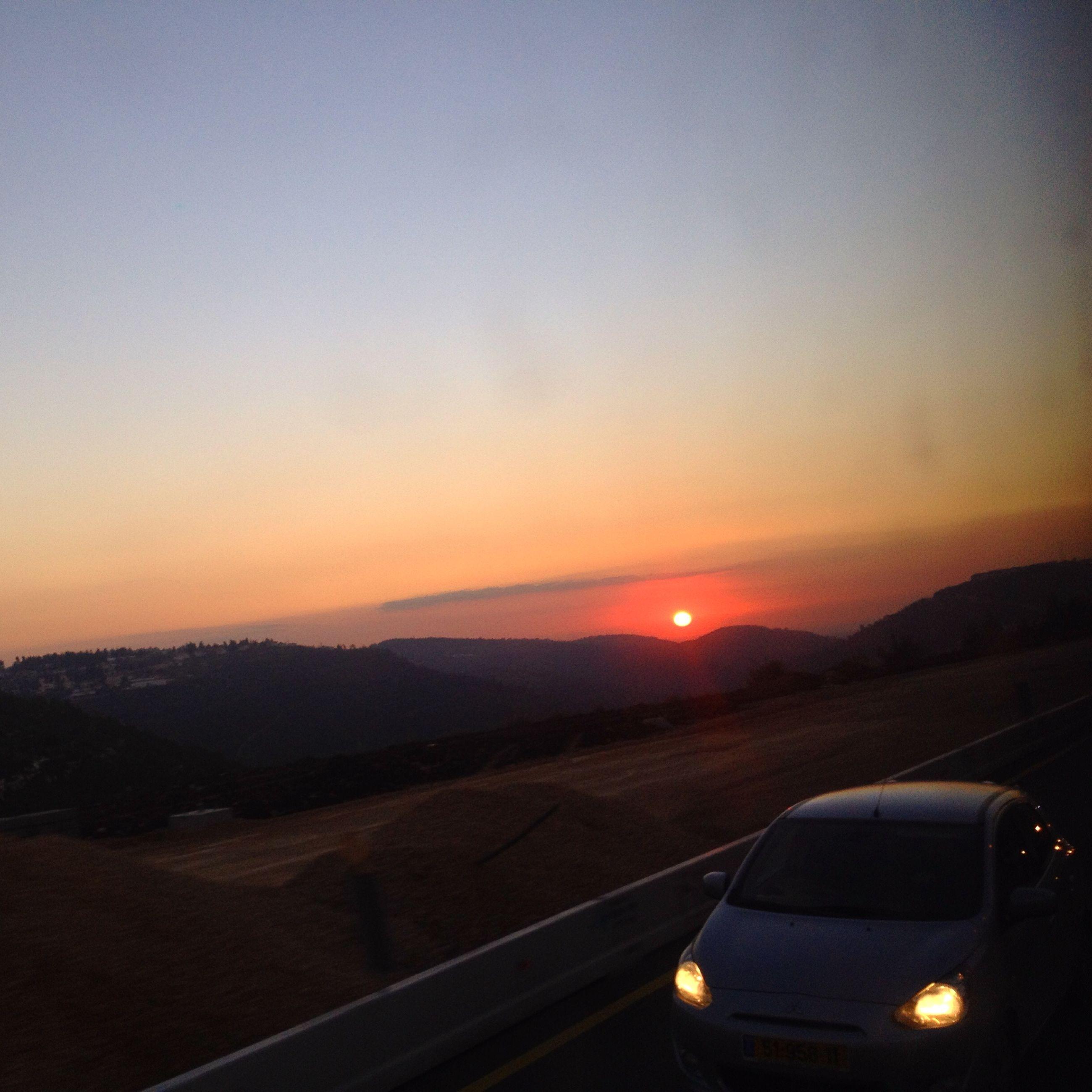 sunset, landscape, orange color, transportation, scenics, beauty in nature, tranquil scene, mountain, silhouette, sun, copy space, tranquility, nature, sky, clear sky, mode of transport, mountain range, idyllic, dusk, horizon over land