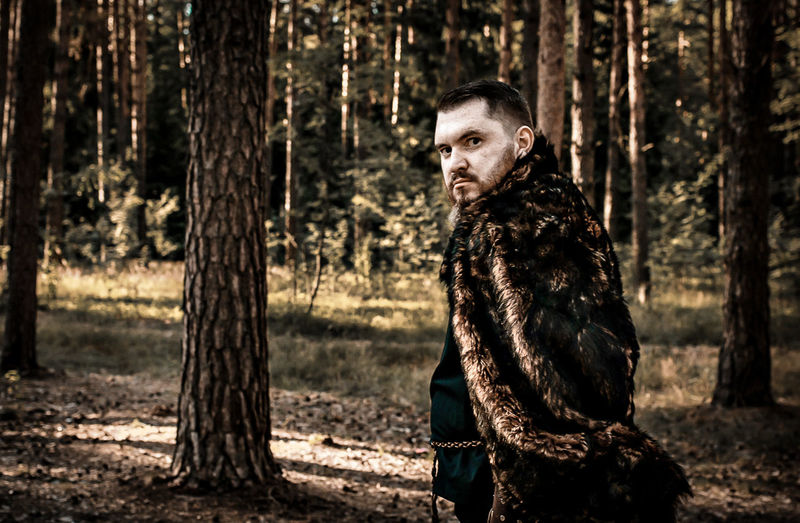 Portrait Of Hunter Standing In Forest