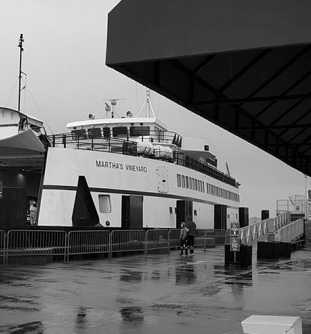 Ferry Boat Ferry Terminal Ferry Passengers Waterfront Rainy Day Built Structure Water Building Exterior Modern Sky Day Person EyeEm Best Shots - Black + White S6