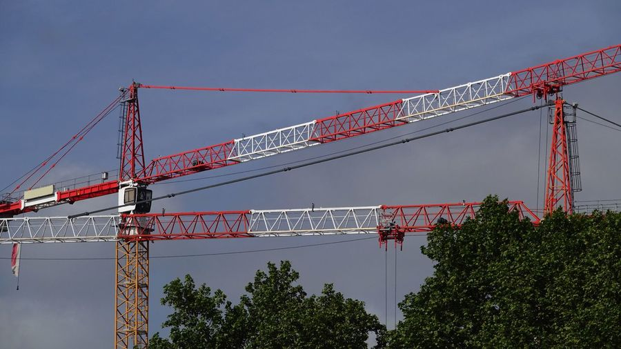 Industry Industrial Equipment Equipment Working High Crane Crane - Construction Machinery Built Structure Sky Architecture Low Angle View Nature Connection Bridge - Man Made Structure Construction Industry Transportation Red No People Clear Sky Outdoors