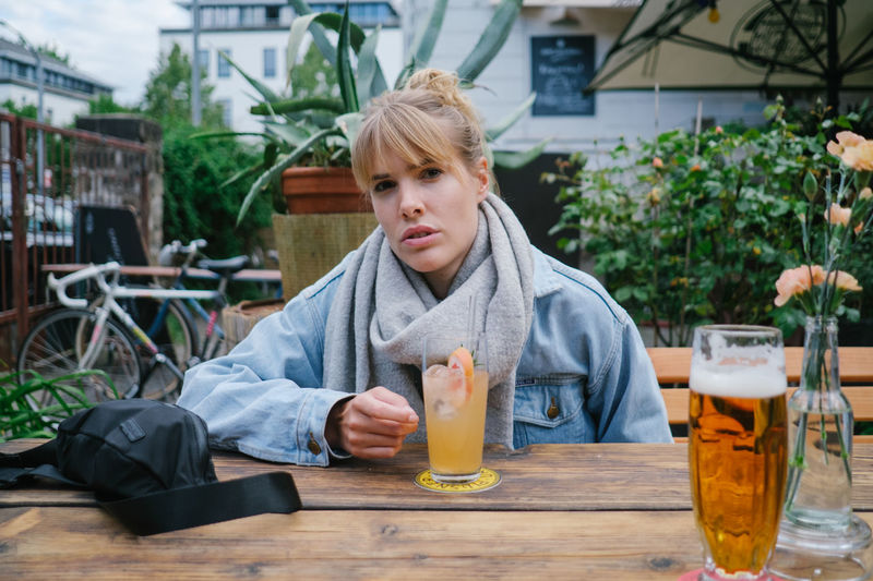 Portrait of woman sitting at restaurant
