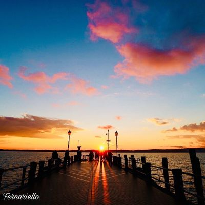 Full Length Standing Lifestyles Silhouette Men Outdoors Sunset Water Sea Beauty In Nature Sky Scenics Horizon Over Water Nature Cloud - Sky Tranquil Scene Pier Tranquility Jetty The Way Forward Vacations Travel Destinations Built Structure Beach No People
