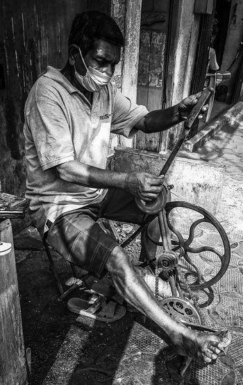 Man working on seat