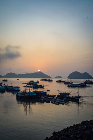 traveling Vietnam 2018 ASIA Travel Traveling Vietnam Architecture Bay Beauty In Nature Cloud - Sky Dusk Explore Fishing Industry Harbor Marina Mode Of Transportation Moored Nature Nautical Vessel No People Outdoors Reflection Sailboat Scenics - Nature Sea Sky Sunset Tranquil Scene Tranquility Transportation Water Yacht
