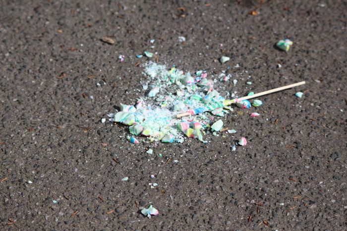 On The Streets Outside Random Pavement Broken Pieces Broken Lollipop In Pieces Colorful Rainbow Colors Randomly Street Showing Imperfection Lollipops Random
