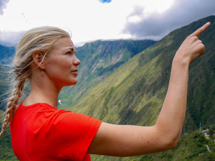 Beautiful young woman against mountains