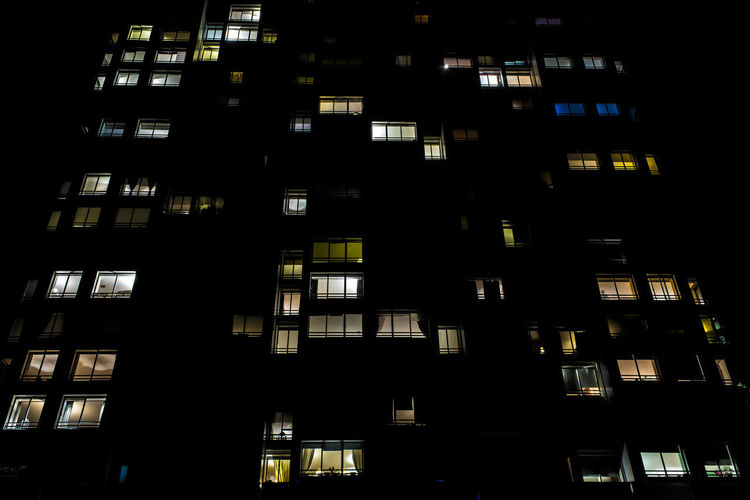 Low angle view of office building at night