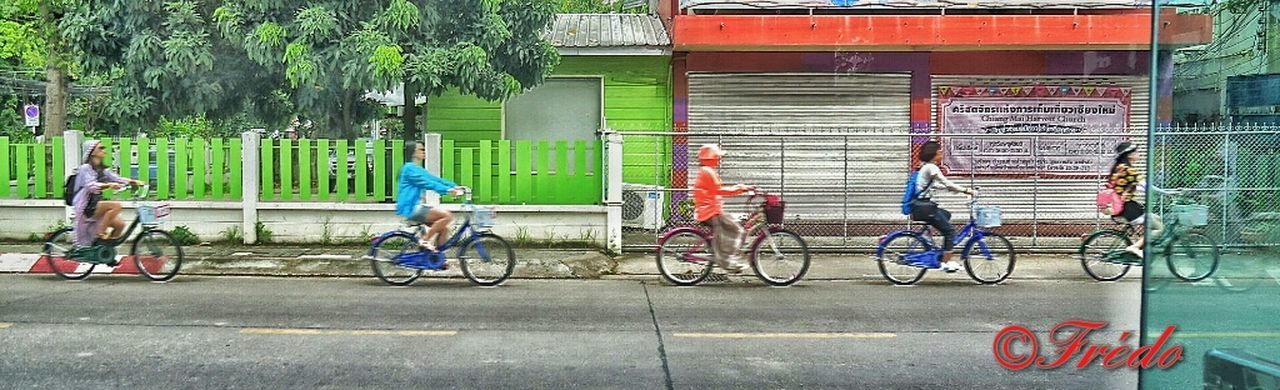 CyclingUnites Bicycle Cycling Mode Of Transport Green Color Transportation People Outdoors Horizontal Colourful Girls On The Road Commuting Happy Ride Commuting Ride Riding Young Adult Streetphotography Fun On Bike