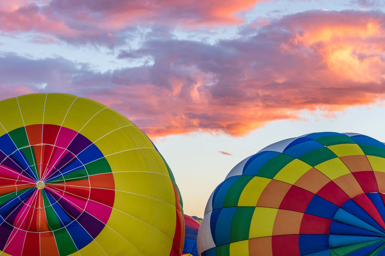 Hot Air Balloons fly over the city of Albuquerque, New Mexico during the mass ascension at the annual International Hot Air Balloon Fiesta in October, 2016 Balloon Ballooning Festival Cloud - Sky Day Flying Heat - Temperature Hot Air Balloon Multi Colored No People Outdoors Sky