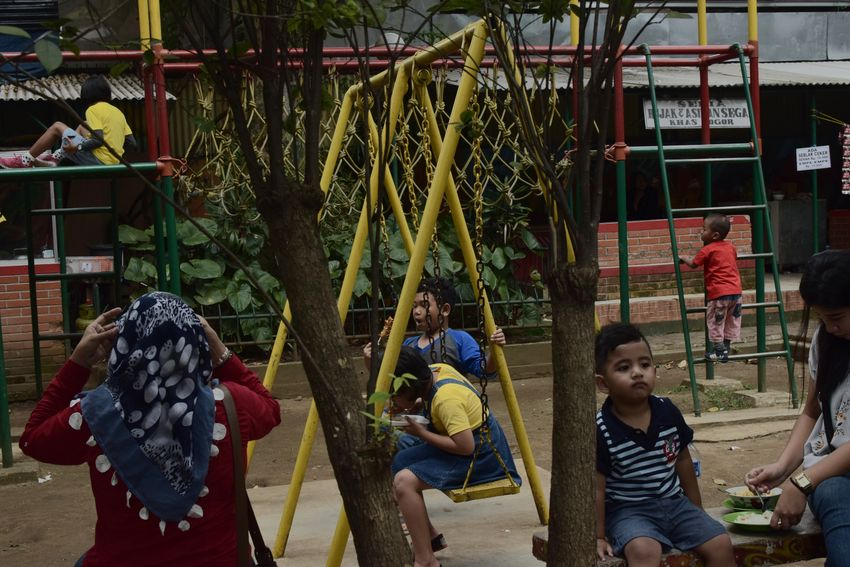 Bogor, January 2018 Streetphotography Documentaryphotography Candid UNPOSED Kid Boy Play Playground Children Childhood Child People Hanging Children Only Boys Market Outdoors Day Lifestyles