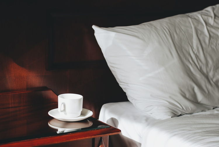 Coffee Cup On Table By Bed