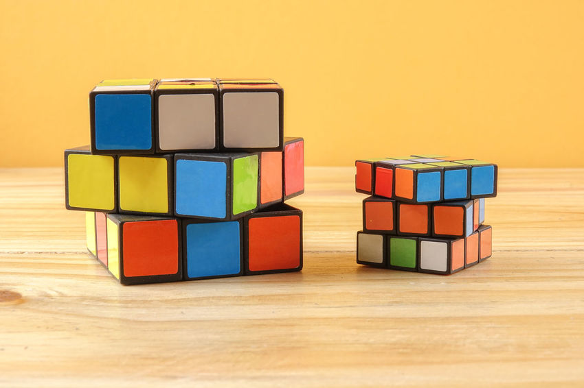 RUBIK'S CUBE , CREATIVITY TOY Creativity Rubik Cube Arrangement Choice Close-up Group Of Objects In A Row Indoors  Intelligence Large Group Of Objects Multi Colored No People Order Rubik Shape Side By Side Stack Still Life Studio Shot Table Toy Toy Block Variation Wood - Material