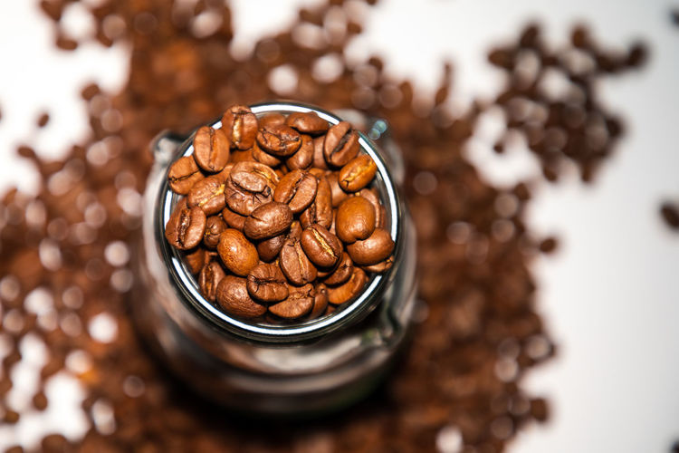 full glass of espresso beans Beans Espresso Brown Close-up Coffee Coffee - Drink Drink Focus On Foreground Food Food And Drink Freshness Glass High Angle View Indoors  No People Nut Refreshment Roasted Coffee Bean Seed Selective Focus Snack Still Life Studio Shot Wellbeing
