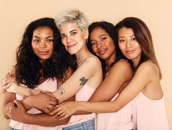 Looking At Camera Portrait Indoors  Women Smiling Togetherness Friendship Young Women Group Of People Beautiful Woman Real People Happiness Diversity Four Different Girls Studio Lifestyles Standing Hugging International Women's Day 2019