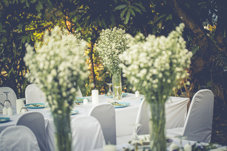 White flowers in vase on table in wedding party