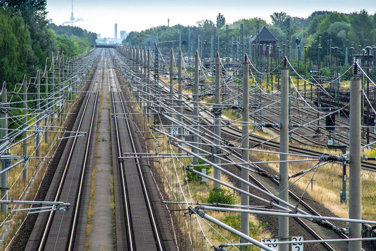 High Angle View Of Railroad Tracks Amidst Electric Poles