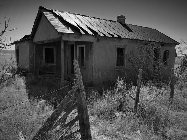"""""""Once Upon A Time In Cedarvale No. 1"""" An abandoned farm house in the near ghost town of Cedarvale, New Mexico. New Mexico Photography New Mexico Black & White Black & White Black And White Blackandwhite Ghost Town Abandoned Buildings Abandoned Places Farm House Architecture Built Structure Abandoned Building Exterior Damaged House No People"""