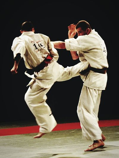 Karate Kyokushin Two People Fighting Black Background Competition Match - Sport People Competitive Sport Karate Kyokushin 1dan Fighters Gi