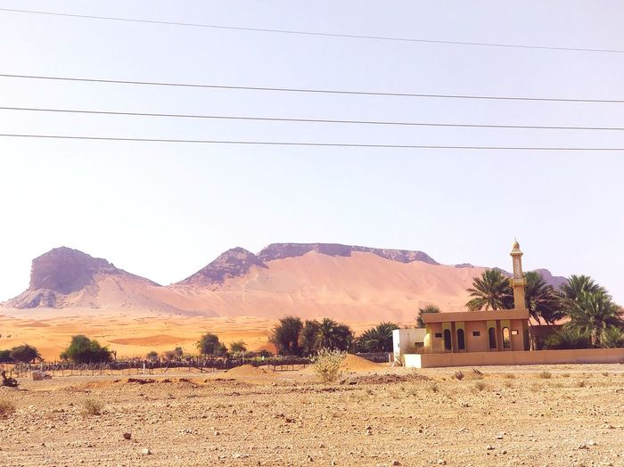 EyeEm Selects Mountain Desert Rural Scene Sky Architecture Building Exterior Landscape Built Structure Place Of Worship Arid Climate Sand Dune Whitewashed Christianity Atmospheric Namib Desert Steeple Cathedral Temple Camel Farmland Arid Landscape Mosque Barren Sand Entryway Catholicism Church Religion Cultivated Land