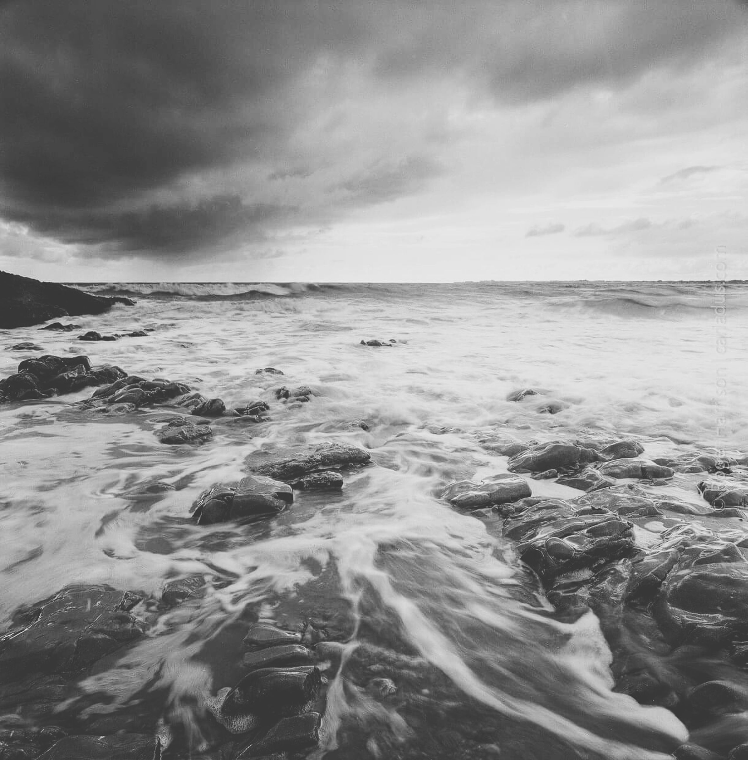 sea, water, sky, cloud - sky, scenics, tranquil scene, cloudy, beach, beauty in nature, tranquility, nature, horizon over water, shore, wave, cloud, idyllic, weather, overcast, surf, remote