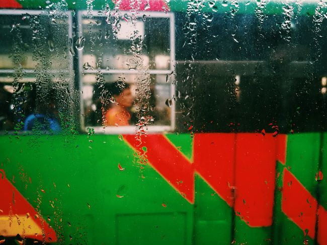 The Street Photographer - 2017 EyeEm Awards Window Rain Capture The Moment The Human Condition Your Design Story Eyeem Philippines EyeEm Best Shots Telling Stories Differently Street Photography Everyday People EyeEm Street Street In Color Colour Your Horizn Stories From The City