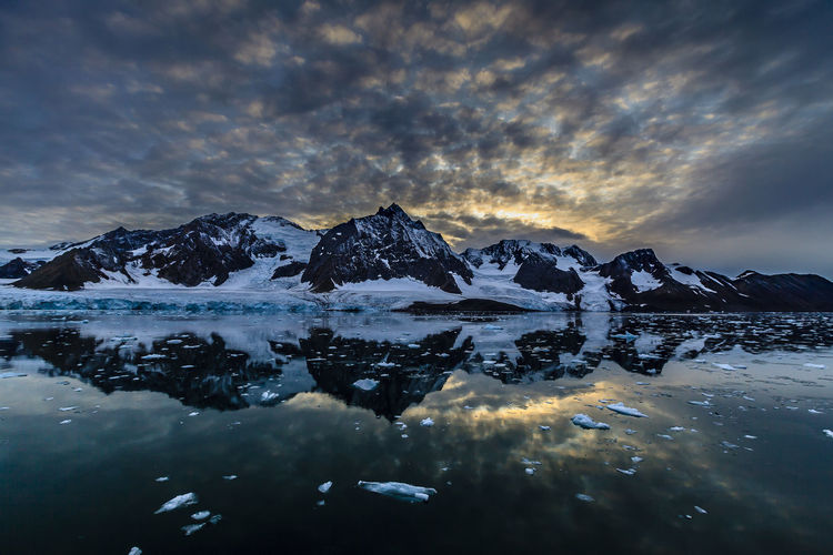 Arctic Beauty In Nature Cloud - Sky Cold Temperature Day Ice Iceberg Lake Mountain Nature No People Outdoors Reflection Scenics Sky Snow Sunset Svalbard  Tranquil Scene Tranquility Water Winter